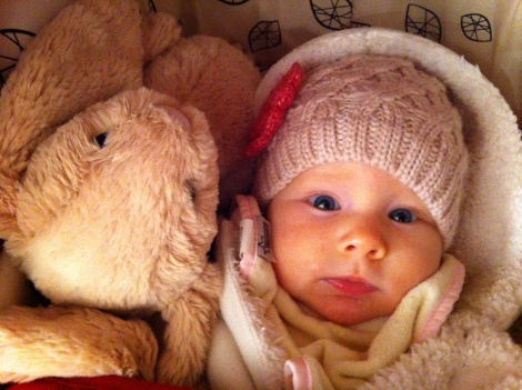 Snuggled in her stroller with her buddy, Lapierre Lapin.
